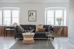Living room in natural shades with white floor and window niches