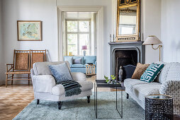 Classic furniture and open fireplace in living room of period apartment