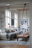 Pallet table in cosy living room in shades of grey