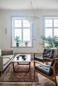 Retro furniture in classic living room with period windows