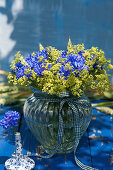 Bouquet of cornflowers and lady's mantle
