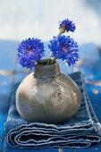 Cornflowers in a spherical vase