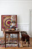 Ethnic-style Christmas decorations on bench and old wooden table
