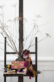 Wrapped gifts, ethnic-style accessories and dried flowers on easel