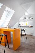 Orange, retro desk in open-plan attic apartment