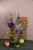 Autumn arrangement of chrysanthemums, hydrangeas, alliums, roses and branches of rose hips