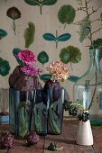 Carnation, chrysanthemum, ranunculus and artichokes in glass vase