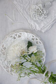 White bouquet of chrysanthemums, carnations, astrantia and cow parsley