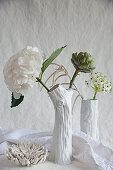 Hydrangeas, artichoke, star-of-Bethlehem and amaranth in white vases