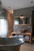 Metal bathtub and sink in classic bathroom