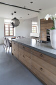 Modern country-house-style kitchen with concrete worksurface