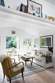 Shelf above open doorway leading into living room with garden access