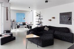 Designer sofa and desk in monochrome living room