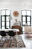 Conference table and classic chairs on kilim rug