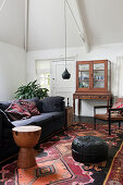 Sofa, Oriental rug and display case in living room
