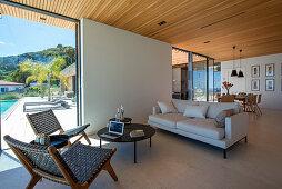 Open-plan living-dining room in modern, architect-designed house
