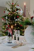 Beer bottles on table festively set for Christmas