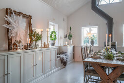 Festively set table in classic dining room with high ceiling