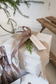 Wrapped gift with torn material used as ribbon