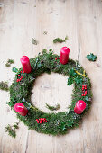 Handmade moss Advent wreath with red candles
