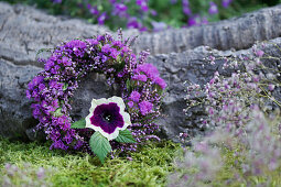 Wreath of broom heather and sea lavender, petunia blossom as eye-catcher