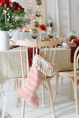 Christmas stockings hung from chair backs