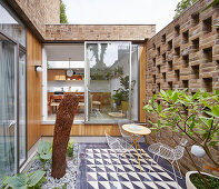 Small, imaginatively designed courtyard of brick house