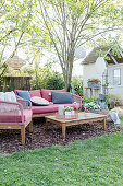 Pleasant seating area with bark chip floor in spring garden