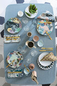 Bird's-eye view of table set in pastel shades