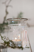 votive with twig and ballet slipper