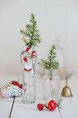 Juniper branches with decorative toadstools in small bottles