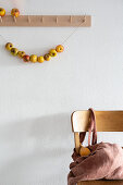 Garland of apples hung from coat rack
