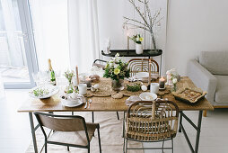 A table laid for an Easter meal in natural colours