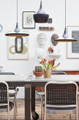 Classic pendant lights above a dining table