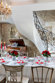 Table festively set in red and white in elegant country house