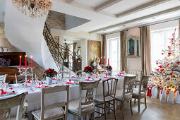 Table festively set in red and white in elegant interior