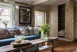 A rustic living room with a built-in cupboard
