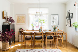 Table and chairs in dining area with pictures on walls