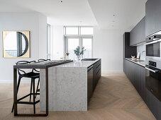 Modern, masculine kitchen in shades of gray with a kitchen island