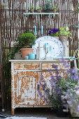 Shabby-chic arrangement on terrace