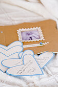 birth announcement thank you cards from a baby shower on heart-shaped paper