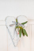 Rose and eucalyptus branch on a white deco heart