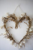 Heart wreath made of dried olive branches and fairy lights