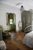 French-style bedroom with an entrance to the ensuite bathroom