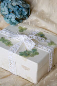 Gift box with dried hydrangeas and lace ribbon