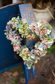 Heart wreath of hydrangea blossoms and snowberries