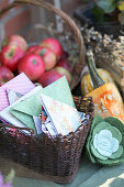 Basket with DIY folded seed bags, a basket with apples, felt succulent