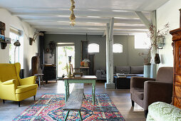 Wooden ceiling beams and vintage furniture in country-house-style living room