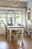 Various chairs around table in vintage-style dining room