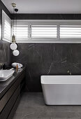 Marble tiles in modern, masculine bathroom decorated in black and grey